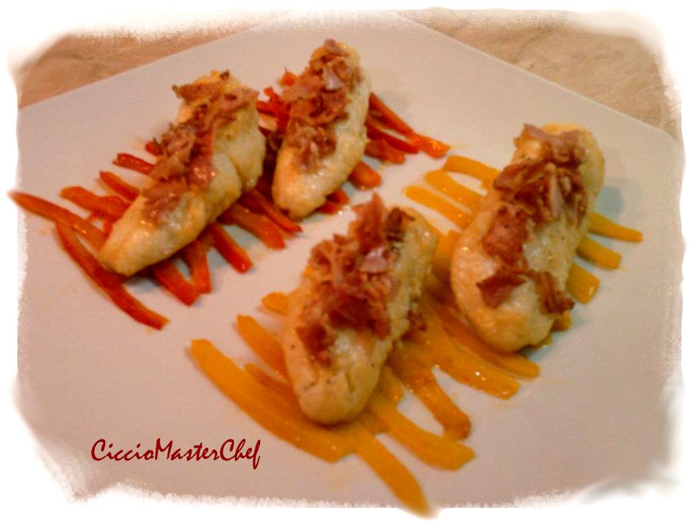 Code di rana pescatrice alla porchetta su dolce letto di peperoni